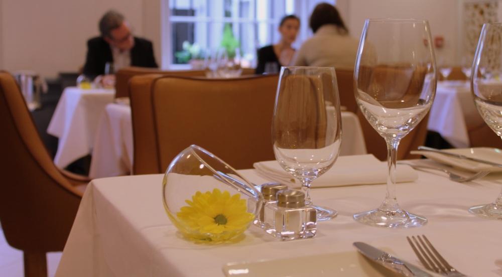Hot stove restaurant dublin table setting glasses flower