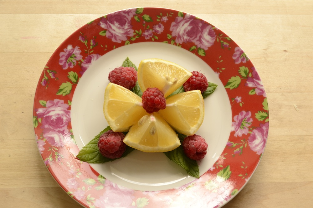 lemon raspberry mint, floral plate with fruit, cut lemon, lemon and mint, raspberry and mint